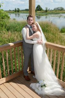 Bride and groom by the water at a beautiful Mitchell wedding by Columbia Photos