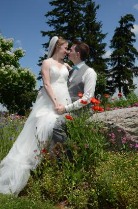 Bride and groom kissing at a beautiful Mitchell wedding by Columbia Photos