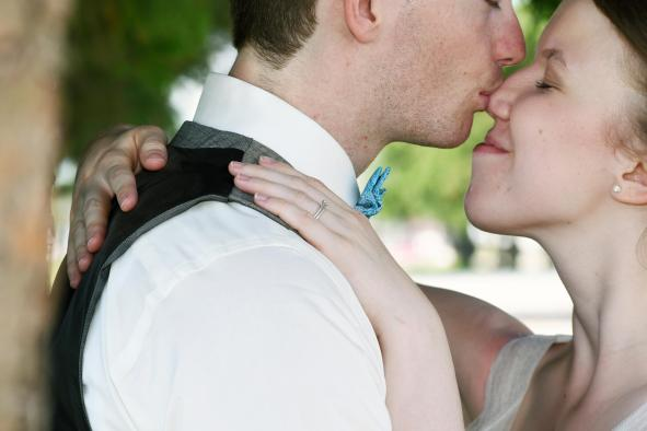 Bride and groom kissing at a Mitchell wedding by Columbia Photos