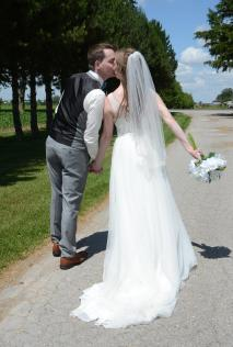 Bride and groom kissing on the road at a beautiful Mitchell wedding by Columbia Photos