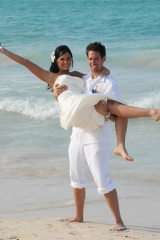Bride and groom on the beach at Punta Cana by Columbia Photos