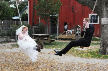 Bride and Groom wedding photo on the swings at Clovermead by Columbia Photos