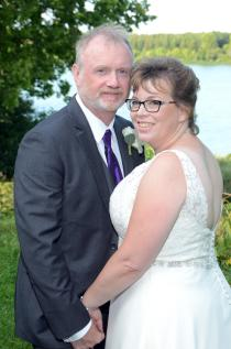 Bride and groom wedding photo with lake in background at Fanshawe Pioneer Village by Columbia Photos
