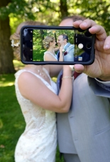 Fun wedding photo of the bride and groom with cell phone by Columbia Photos. Columbia Photos is wedding photography based in London Ontario.