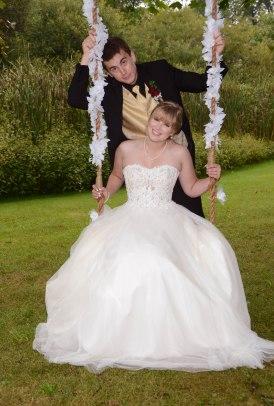 Swing wedding photo by Columbia Photos