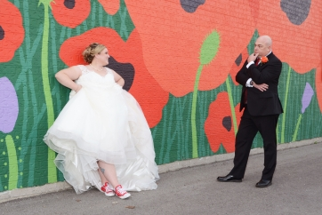 Wedding Photo of the Bride and Groom at the poppy wall in St.Thomas Ontario