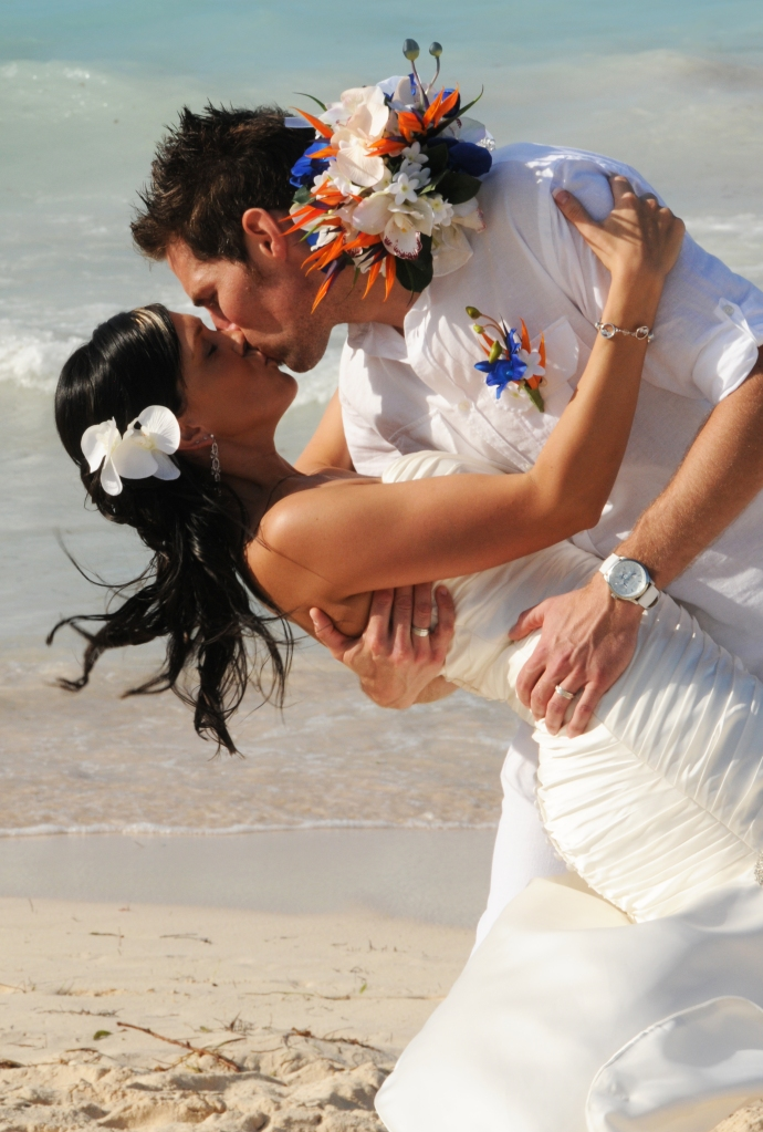 Kissing on the beach by Columbia Photos based in London Ontario